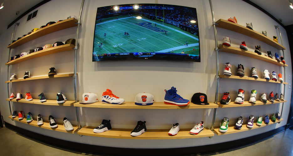 Daps Feltman's awesome shoe wall. What goes better with burgers than sneakers and sports?