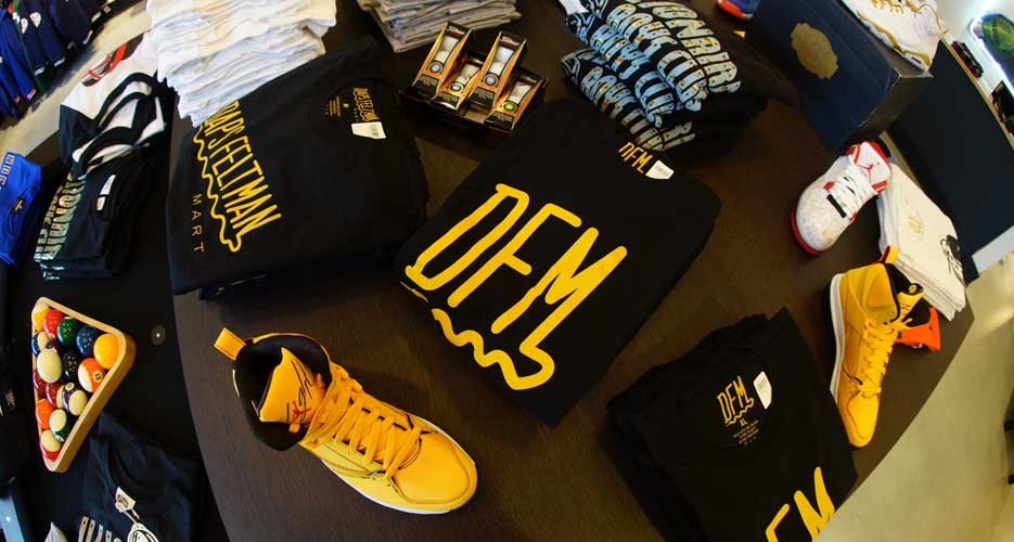 Squiggle of mustard or shoelace? The designs of Daps Feltman tee shirts reflect the double life of the store.