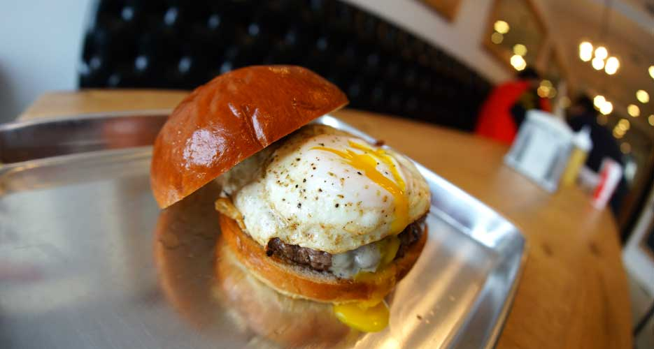 The holy trinity of brioche, burger, and egg.