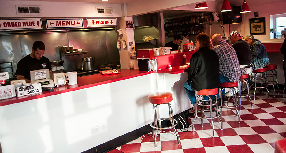 The counter at Super Duper Weenie has a retro diner feel.