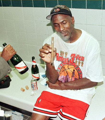The Michael Jordan way, part 1: Stogie? Check. Bud Light chaser? Check. Complete confidence in your superiority to all other humans? It's a celebration, biiittcchhheeess.