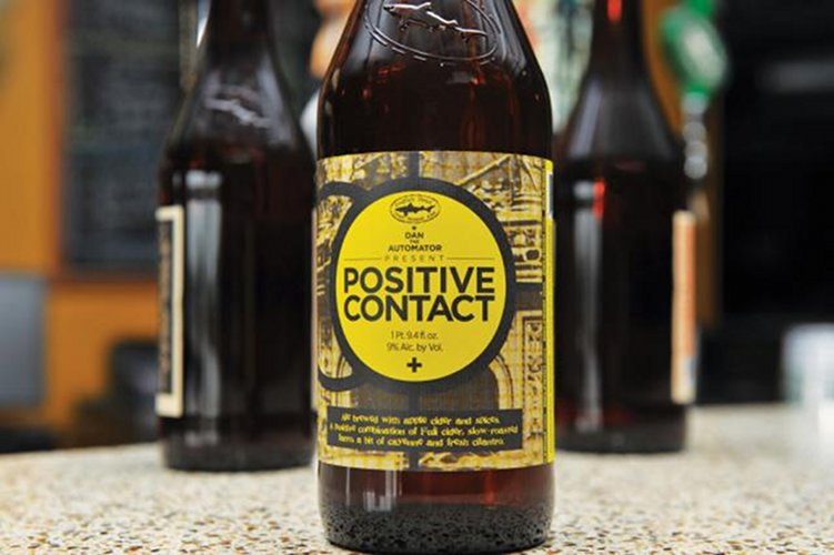 Dogfish Head Positive Contact. Another ground-breaking release from the Dogfish camp, the concept for this slightly sour Belgian-style ale—brewed with Fuji apple cider, cayenne, and cilantro—came out of discussions with producer Dan the Automato. It was released in a box set with a 10-inch vinyl EP of four new Deltron 3030 remixes, plus pairing recipes from the likes of Mario Batali. (Photo: