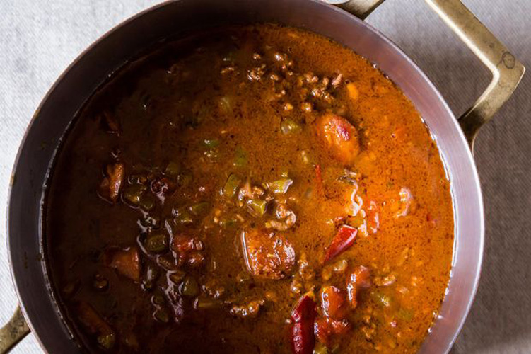 Chili Gumbo. In honor of the host city of New Orleans, a sacred nacho condiment gets a well deserved upgrade built on a dark roux, andouille sausage, and a heap of Cajun seasoning.
