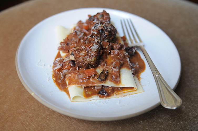 "Meatballs. Ok, maybe ground short ribs aren't an everyday ingredient, but this recipe can easily be made with good quality ground beef, so it stays. We like how the instructions command us to scoot some sauce into the pasta folds as we ""bunch"" the lasagna sheet on the plate."