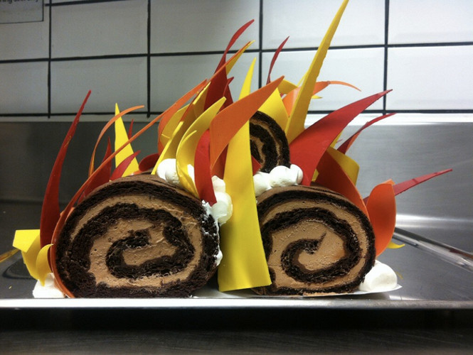 This buche de hot flames isn't a Guy Fieri homage, but rather a cake made by the Per Se staff to commemorate the time Thomas Keller's restaurant caught on fire.