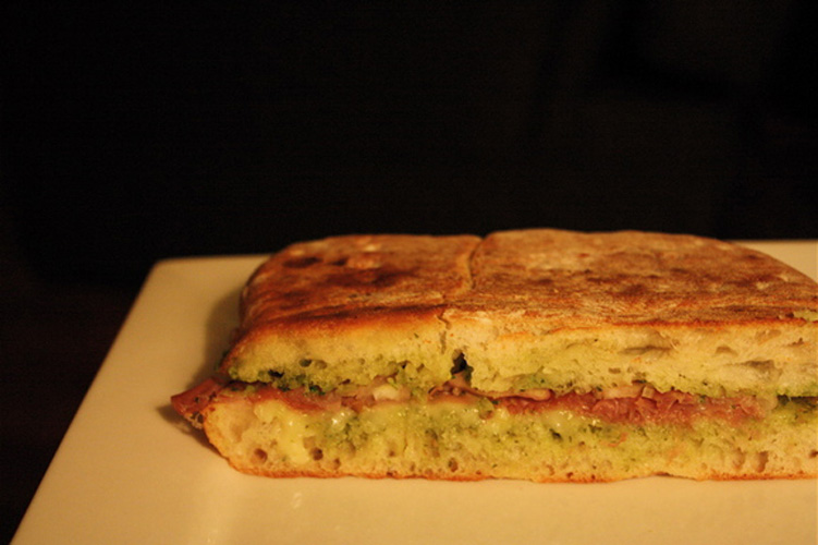 Pesto. You probably already know how to make a panini, so the arugula pesto is the focal point here. What, you thought we were going to tell you to make basil pesto? It's winter!
