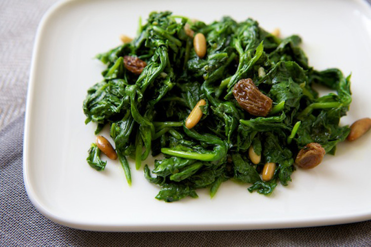 Spinach and raisins. The Italians know how to meld sweet and savory in a single dish better than just about anyone, and this recipe is the case in point. One bite and you'll be forever demanding wine-soaked raisins with your sauteed spinach.