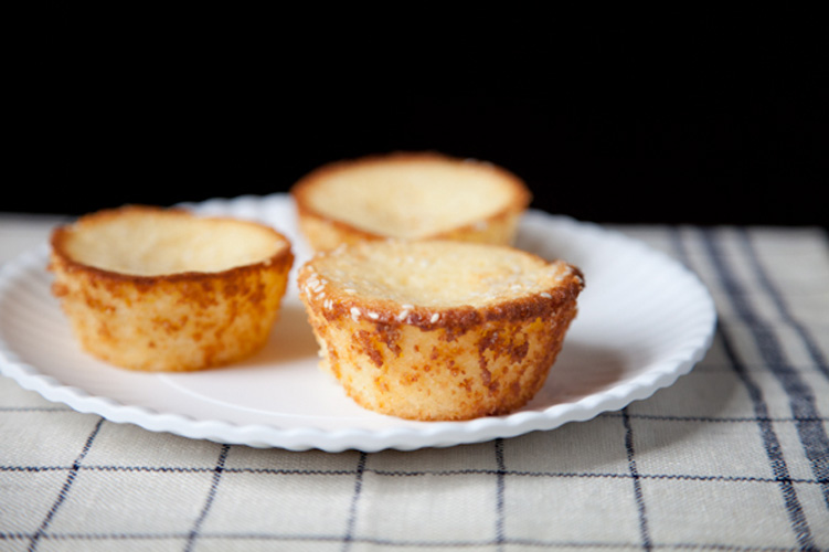 """Salvadoran Breakfast Cakes (a.k.a. Quesadillas). These Salvadoran """"quesadillas"""" are a unique blend of sweet, savory, and tangy, with the texture of a fine, delicate corn muffin and a perfume of parmesan. The edges of the little cakes crisp and brown beautifully, while the centers remain snow white and tender."""