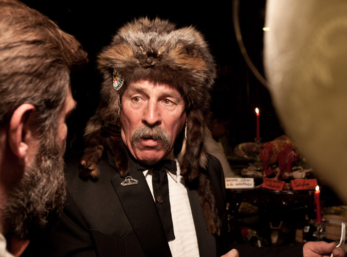 Trapper Bill Guiles, who provided the evening's protein, wears a grey fox pelt with his tuxedo.