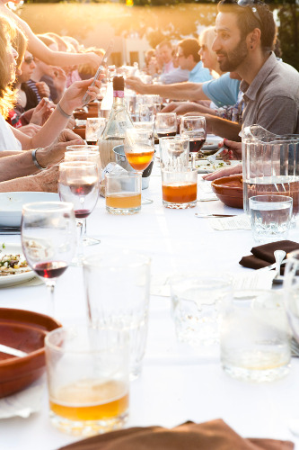 Milliron was there to capture the joviality of this outdoor farm benefit dinner last summer.