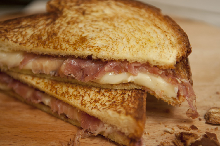 Brie and Prosciutto Melt. It's just a grilled ham and cheese right? Hardly. The bread is buttery brioche, the cheese is extra rich brie, and the ham is prosciutto.