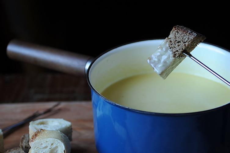 Traditional Fondue Fribourgeois. Nutmeg, pepper, lemon juice, and a shot of Kirsch bring this mix of molten cheese an wine to life, and a touch of cornstarch thickens the mixture and keeps it from breaking. This is a loose fondue, clinging gently to whatever you dip in it; if you like yours more substantial, just stir in a little extra cornstarch, thinned with a few drops of water.