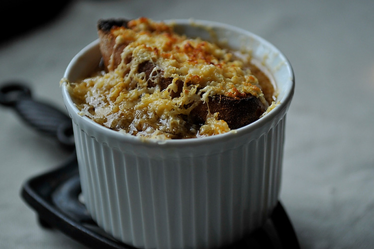 French Onion Soup. This is almost, but not quite, the traditional French onion soup that comes to mind. After all, it calls for 2 full cups of wine or beer. We used a dark ale and really liked the bit of kick that the finished soup still had after 2-plus hours on the stove.