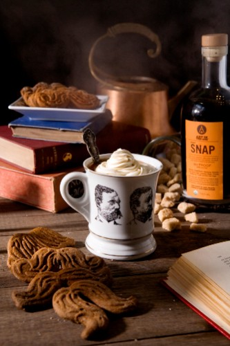 This scrumptious set features black coffee topped with whipped cream made with SNAP liqueur and ginger-snap mustaches. GINGER MUSTACHES.