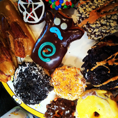 The bacon, maple syrup, Tang, and Oreo varieties at Portland's Voodoo Donuts sound like the business. (Photo: @Saveur)