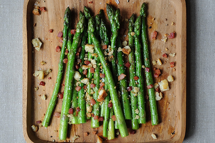 Asparagus with Pancetta.         Sometimes when you learn something new in the kitchen, you feel embarrassed that you hadn't figured it out sooner. Cooking asparagus was that way for us. Turns out, it's best simply sauteed. Get the recipe.