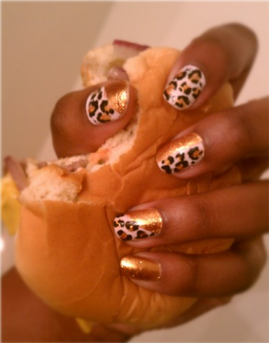 We don't need to tell you that animal-print nails are fierce—as is violently crushing an innocent cheeseburger from Wendy's.