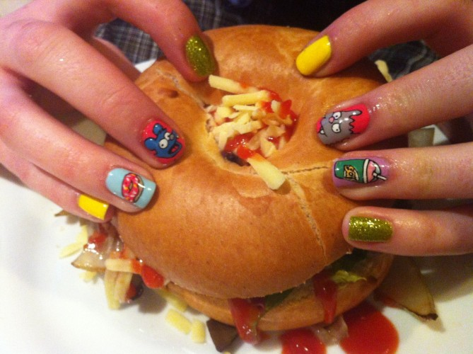 "We'll forgive that disaster of a DIY vegan bagel burger because those nails are fun and the ""burger"" looks like something from the Muppets."