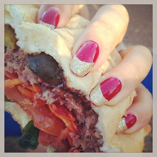 "Australian opera singer and cabaret performer Ali McGregor submitted a burger pic with diaphanous red nails (her ""show nails"") and a Wagyu burger with extra cornichons from Diablo's Oven in Western Australia. Sounds about right for an opera singer."
