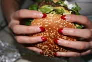 Heart-tipped nails are in love with this giant cheeseburger with avocado from Berlin Burger International.
