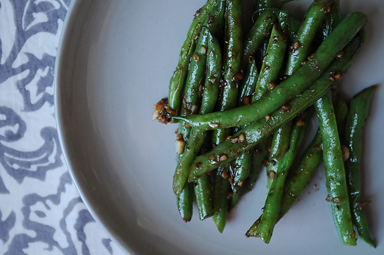 Asian Garlic Green Beans. If you make this, your kitchen will smell like Chinese take out, and we mean that in the best possible way. Just watch your hand as you sprinkle the red pepper flakes. A little distraction will lead to a rather hot mouth.