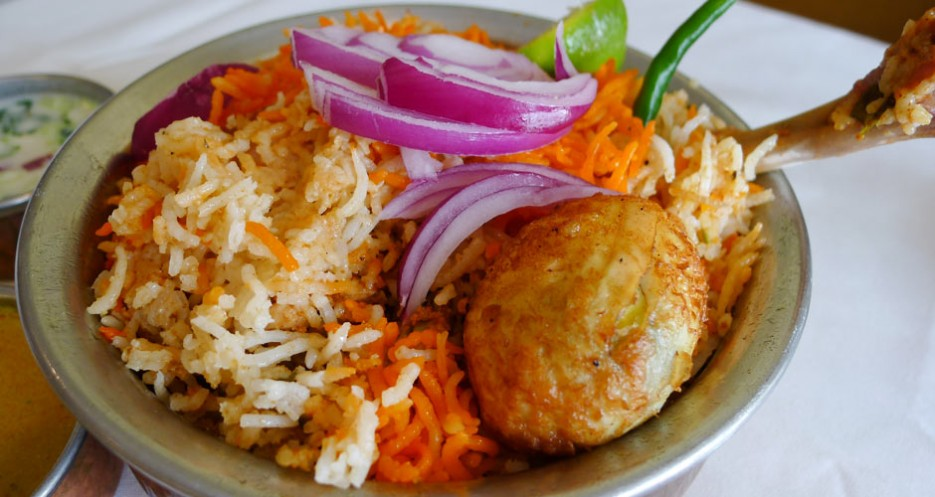 Chicken biryani at Deccan Spice contains a boiled egg that has been deep fried. Where have you seen that before?