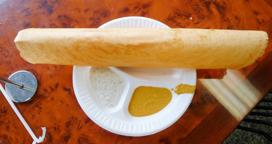 The butter masala dosa at Dosa House is served with homemade coconut and peanut chutneys. Eat it with your fingers by tearing off little pieces and dipping.