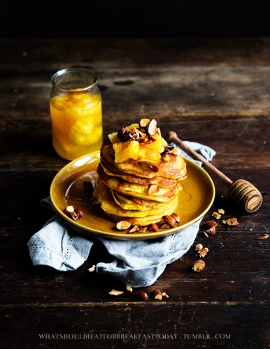 These orange pancakes look great, but we're also interested in how cool it that she has a honey dipper for occasions like this.