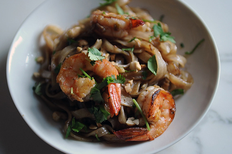 Shrimp Pad Thai. Tangy tamarind is the secret ingredient to great pad thai, but other than that lesser-known ingredient (note: Whole Foods sells it) everything else you'll need is totally familiar. We love the touch of using honey roasted peanuts instead of the standard plain sort that's often austerely called for.