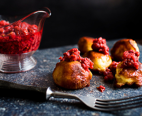 These are Polish-style pancakes and raspberries.