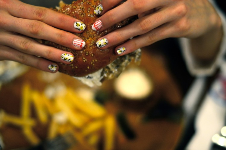 This mani-ac styled her nails after Tory Burch's SS13 collection and picked up a cream cheese cheeseburger from Foster's Hollywood in Spain.