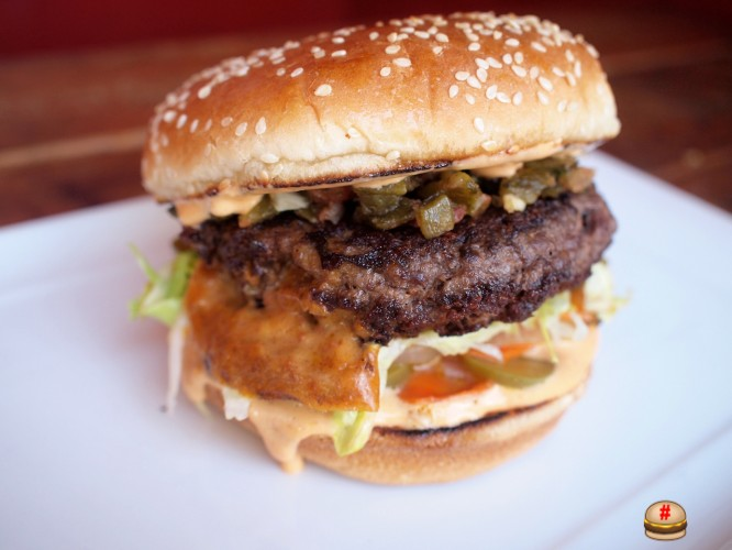 The Maron burger from The Oinkster is stuffed with queso fundido and topped with house-pickled veggies. Swoon.