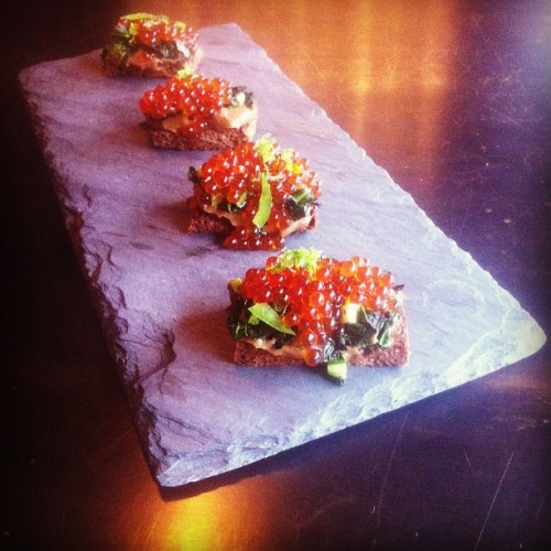 @aldernyc steps into the Insta universe with a pumpernickel crostini topped with trout roe, ponzu, kale, and sunchoke.