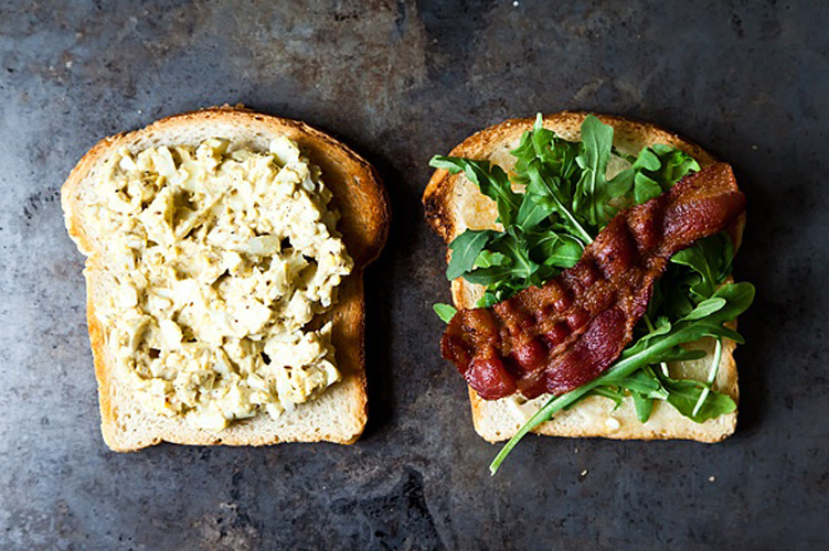 Bacon and Egg Salad with Dukkah and Peppery Greens. Anyone who keeps hard-cooked eggs on hand knows that, despite good intentions, they're sometimes forgotten. This sandwich will give you a great reason to use them up, along with a handful of greens, and the last slices of bacon in your fridge.