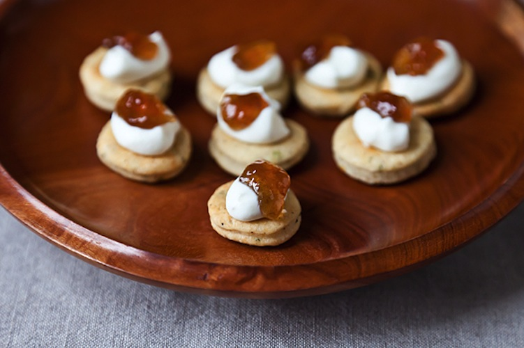 Herbed Biscuit Bites with Ricotta Cream and Onion Jam. Paired with mild ricotta and sweet-tangy onion jam, these tiny biscuits are one-third of a power pop trio. The rosemary contributes a savory, resinous note, the Parmesan gives them plenty of umami, and the black pepper makes an excellent foil for the cool of the ricotta and sweetness of the jam.