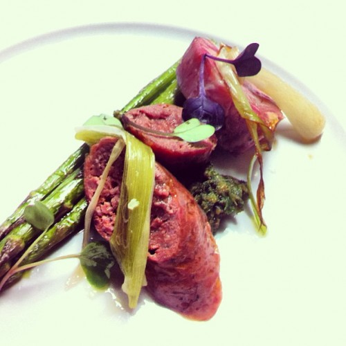 Lamb loin and sausage, ramp romesco, charred spring onion, peas, and asparagus look like a pile of happiness from Sarah Simmons and Co. at @citygrit.