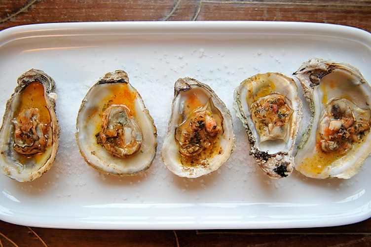 Grilled (or Broiled) Oysters with Sriracha Lime Butter. We wish more people would grill or broil oysters—it's so easy, and the quick blast of heat concentrates the oysters' brine and browns their tips without drying them out.