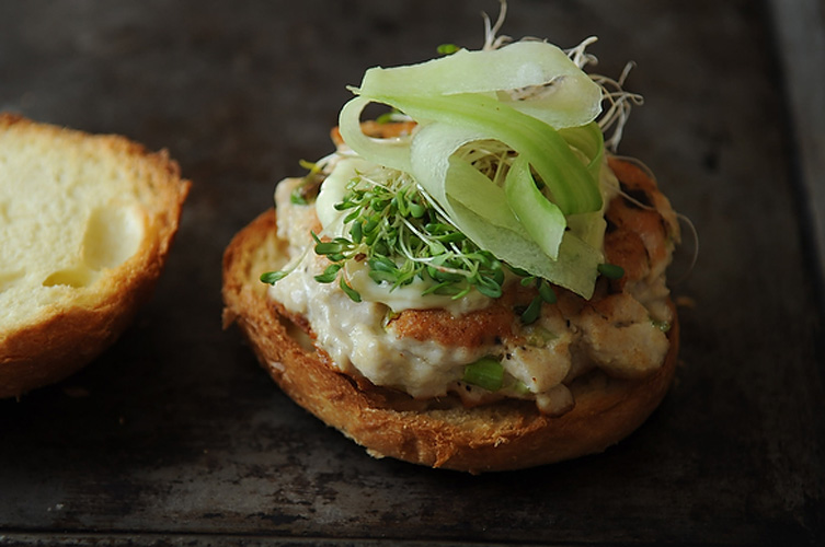 Tuna Burgers with Wasabi Ginger Mayo. The clean, fresh flavors of these unexpected burgers will quickly win you over. Chopped sushi-grade tuna is mixed with fresh ginger and scallions, molded into patties, pan fried and then topped with cucumber, sprouts and a zippy pickled ginger and wasabi-infused mayonnaise.