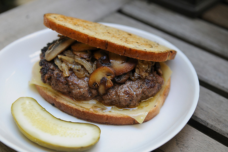 Patty Melt. This will take you back to the 1970s, and you'll want to stay there until you've enjoyed every last succulent bite of this patty melt. You season the grass-fed burger meat (that's a 21st century move) with mustard and Worcestershire, slap and nudge it into a patty, and fry it up in a pan. Then you layer the burger on rye bread, toasted in a pan with butter and topped with Gruyere, and sauteed onion and mushrooms.