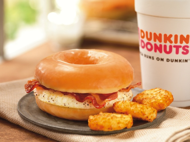 "Glazed Donut Breakfast Sandwich from Dunkin' Donuts. ""Egg patty"" and bacon sandwiched between a glazed donut. At only 360 calories, this is the least gut-bombtastic thing on the list...but still. (Photo: Eater)"