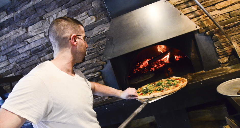 At Brio's Pizzeria, owner Mike Ricciardella's nephew hand-tosses the pizzas and cooks them in a wood-fired oven.