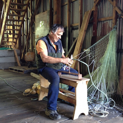 """""""Niño hanging a 25 fathom shackle of gill net in preps for the Bristol Bay Sockeye Salmon season. Gill netting here is not to be confused with high seas illegal gill netting. No bycatch here in the bay, we are the good guys:)"""""""