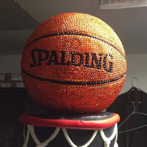The round cake basketball that crowned the tiered cake was covered in 36,000 Swarovski crystals. (Photo: Facebook)