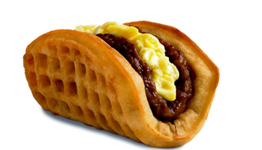 Waffle Taco from Taco Bell. Masters of the fast food mash-up, Taco Bell did a limited launch of their sausage, scrambled egg, and maple syrup-filled Waffle Tacos in Southern California recently. Watch this space. (Photo: Daily Finance)
