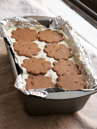 11. Spread with more cream, then more cookies, then more cream, then more cookies. Aim for 8 layers, or until your loaf pan is full, ending with a layer of cookies. Place plastic wrap over the loaf pan and refrigerate overnight.