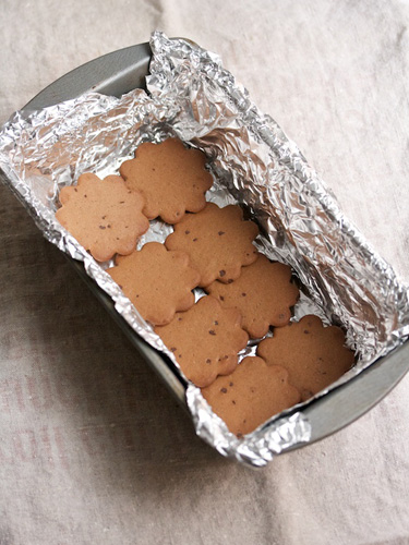8. Line the bottom of the loaf pan with cookies, overlapping them slightly if necessary.