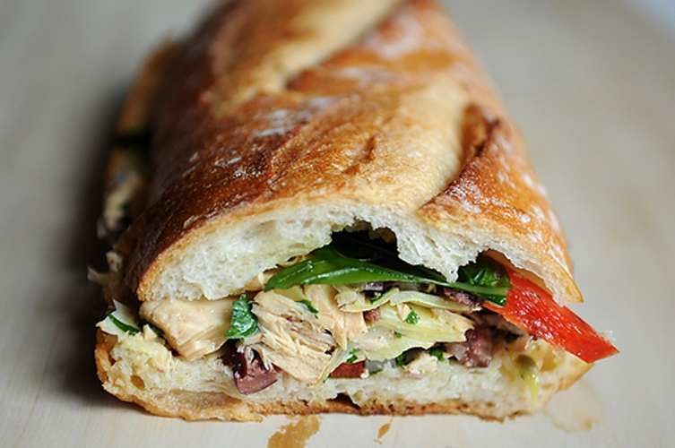 Pan Bagnat: Le French Tuna Salad Sandwich. A decidedly Nicoise tuna salad is pressed between two garlic -and oil-slicked halves of a baguette and left in the fridge overnight, which allows all of the juices to soak into the bread. Get the recipe.