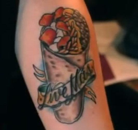 Justin's infamous 'Live Mas' Beefy Crunch Burrito tattoo. (Photo: eater)