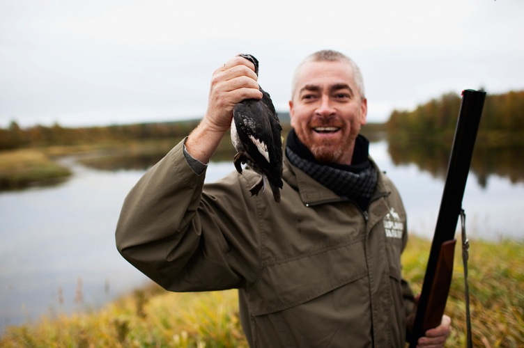 """Alex Atala celebrates after taking a successful shot at Cook it Raw Lapland 2010"""
