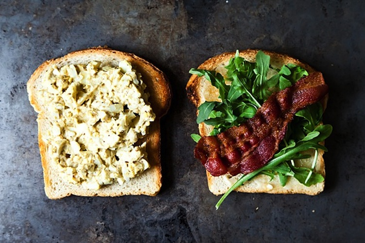 Bacon and Egg Salad Sandwich with Dukkah and Peppery Greens. You've never heard of dukkah, but it's a nutty, seedy spice blend that is begging to be eaten with eggs. Make a big batch once and you'll be able to store it in your fridge for weeks. Whenever your basic egg salad needs a bit of sprucing up, add a generous amount of dukkah—and a healthy helping of crispy bacon.